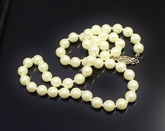 Vintage Faux Pearl Necklace Black Rhino Design Single Strand Soft Creamy Colour Hand Knotted w Gold Tone Clasp Signed Avon