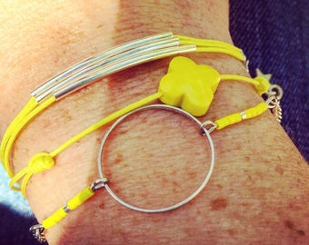 3 yellow and silver cuff bracelets