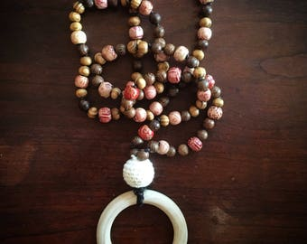 Mama Malas: Luke. 108 wooden teething prayer mala necklaces for the yogi mamas and their teething babies.