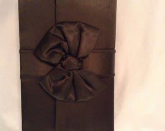 La Regale black satin bow clutch with hand slip