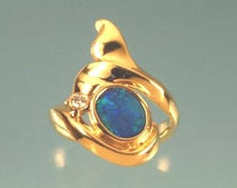 Australian boulder opal set in custom carved 18k yellow gold whale tail ring
