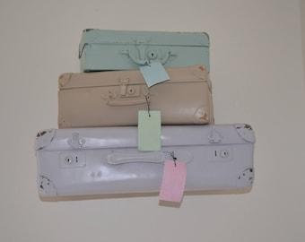set of three vintage suitcases