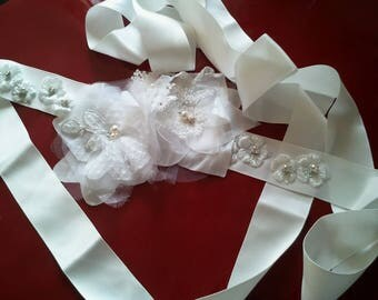 Nice natural, white or Ecru white color satin bridal belt decorated with satin white flowers.