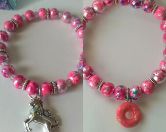 Psychedelic paint splatter groovy abstract glass beads with Choice of Unicorn or Doughnut charm