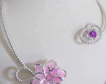 silver necklace and pink flower