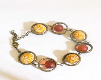 Bracelet in bronze, amber and yellow