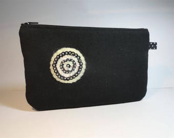 flat black canvas with felt macaroon pouch embroidered sequinq black and white