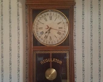 Antique circa 1900 regulator clock Ingram with date indicator very nice antique