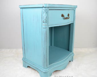 SOLD - Dixie light blue distressed nightstand. End table painted with Annie Sloan chalk in provincial. One available.