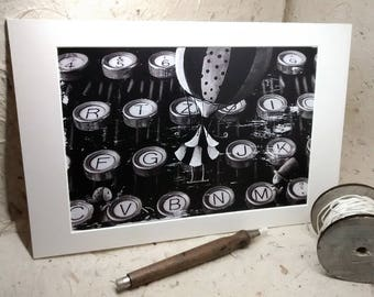 "Press illustration ""Typewriter"" framed by passepartout"