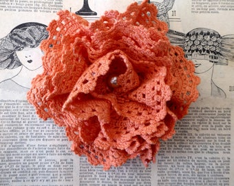 Orange flower brooch made from hand dyed crochet, repurposed