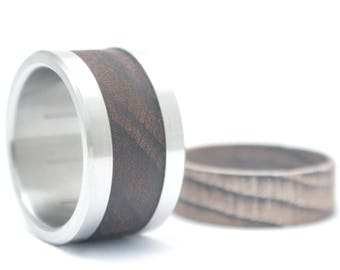 Mood Interchangeable Ring with 2 interchangeable inner rings made of ebony wood and ash wood. Swiss design. Swiss made.