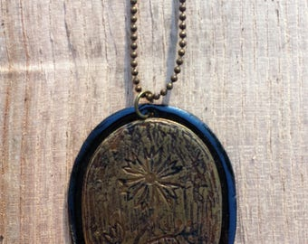 Etched brass and black enamel necklace