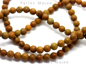 20 perles en bois grain rondes dimensions 4 mm