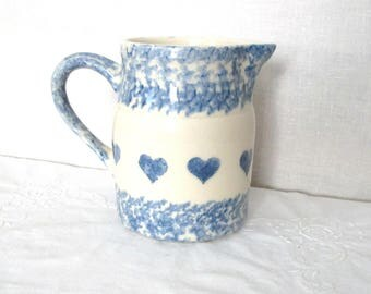 Friendship Pottery, Roseville Ohio, blue and white spongeware heart water pitcher. Holds almost 1 quart. In good used condition
