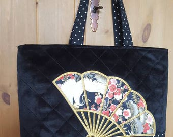 Quilted tote bag with machine embroidered design on applique design.