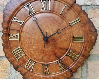 Yellowbox burl clock with natural edge.