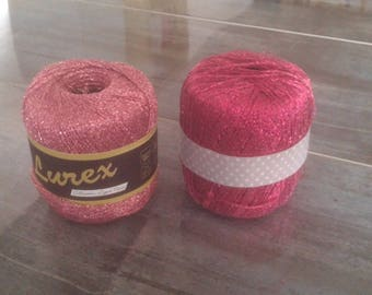 A set of two spools of thread lurex pink and fuchsia