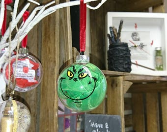 6cm glass bauble, with Grinch face. Can be personalised.