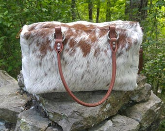 Gorgeous brown and white speckled cowhide overnight bag!