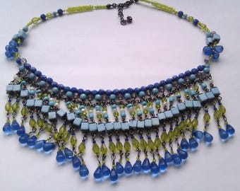 blue and green plastic bead tassel bib necklace