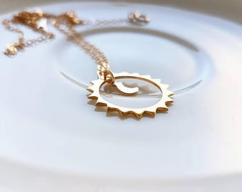 Sun and Moon necklace. Minimalist necklace formed by a delicate gold chain and a sun a small moon