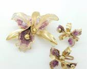 50s Jewelry: Earrings, Necklace, Brooch, Bracelet Vintage 1950s Orchid Earring  Brooch Set With Purple and White Enamel $22.00 AT vintagedancer.com