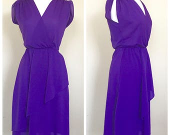Bright purple vintage day dress. Fits a women's US size Medium 8/10.