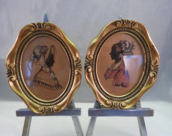 pair of antique gilt framed hand painted miniatures in oval of silhouette portraits,signed (2)