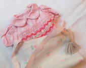 Two dresses for dolls, 36cm with a little bit deliciously vintage patterns with their embroidered smocking.