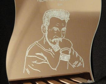 Florent Pagny portrait engraved on wave-shaped mirror.