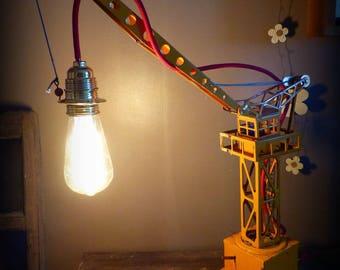 Industrial style desk lamp, vintage. Children's toy crane plate