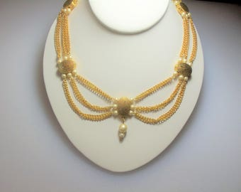 Vintage Gold Tone Festoon Swag Triple Chain Necklace with Engraved Ovals and Faux Pearl Accents