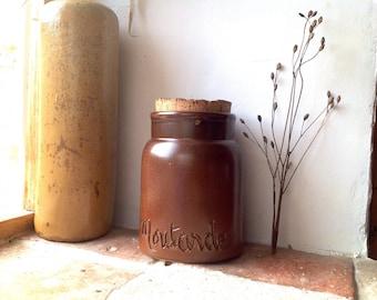 Mustard pot in brown sandstone