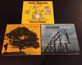 3 Jack Johnson CDs - In Between Dreams, To the Sea, Curious George
