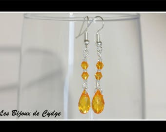Earrings and its drop orange with its tops