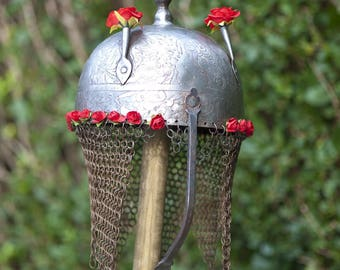Helmet Persia genuine antique topped with flowers
