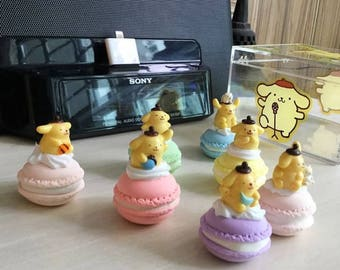 Handmade Pompompurin figurines atop macaroons (set of 7)