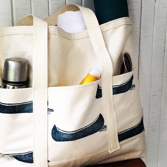Large bag for the beach, market, yoga, diapers, or as a carry on!  Organic canvas, six pockets, one of a kind hand printed tote!