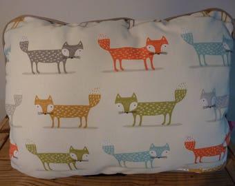 Fox with grey piping cushion