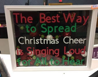 Shadowbox the best way ro spread christmas cheer is singing loud for all to hear