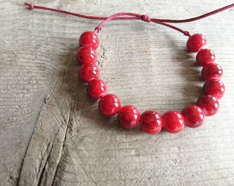 Red ribbed glass pearl bracelet black. Boheme.boho cotton sliding knot fits all wrists. With or without charm