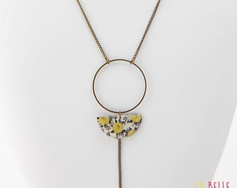 Necklace long pendant half moon resin black and mustard yellow floral pattern