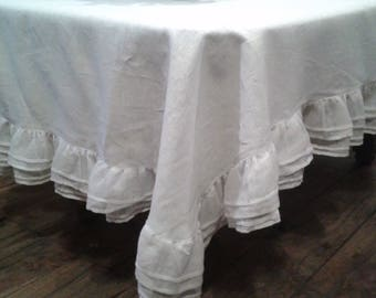 Beautiful white tablecloth in linen with Ruffles for a romantic decor