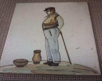 Man standing tile/trivet made in Spain in mid-1900s