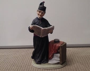 The padre's hobby (2415) a Capodimonte porcelain figurine from Italy in mid-1900s