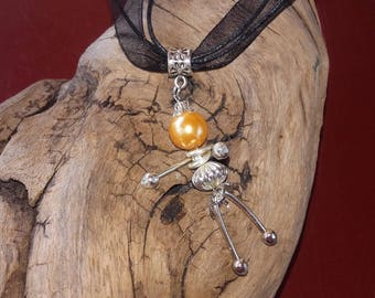 Doll, orange and silver pendant necklace