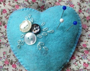 Heart  shaped  felt pincushion. Soft blue  felt. Buttons  and hand  embroidered. Gift  or present .