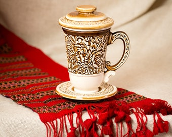 Beige ceramic tea-brewer in traditional style: pottery mug with saucer and lid