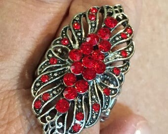 Large silver tone adjustable beaded ring with red stones